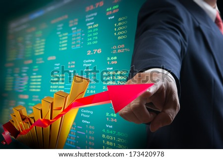 Business man point to up graph of stock market - stock photo