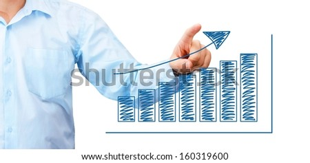 Business man pointing at blue bar chart for business growth concept