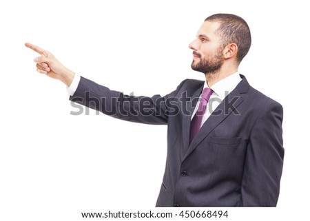 Business man pointing at copyspace, isolated on white background - stock photo