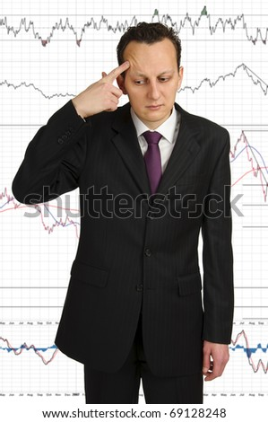 Business man pointing at himself with forefinger. Studio shot with diagrams background - stock photo