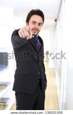 Business man pointing at something with his finger - stock photo