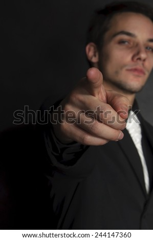 Business man pointing finger at you