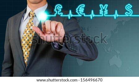 business man pointing  on glow wave of world currency sign - stock photo