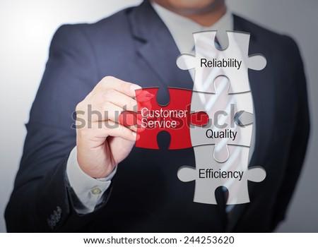 Business Man pointing on jigsaw written word success - stock photo