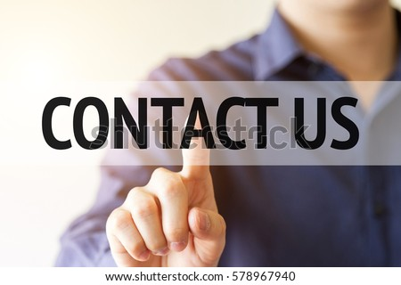 business man pointing on virtual screen with text word: contact us - business concept