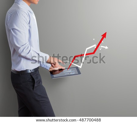 business man pointing tablet with increasing arrow graph, successful concept