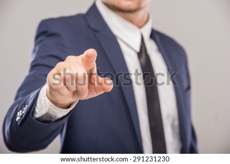 Business man pointing the finger at you, isolated on white background - stock photo