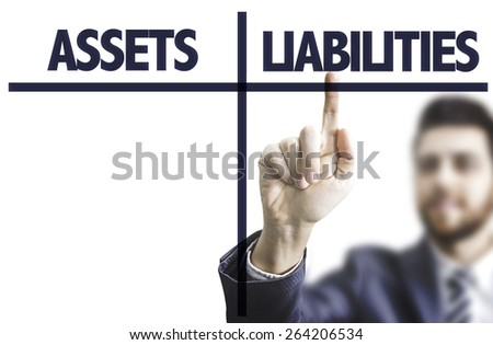 Business man pointing the text: Assets Liabilities - stock photo