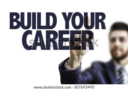 Business man pointing the text: Build Your Career - stock photo