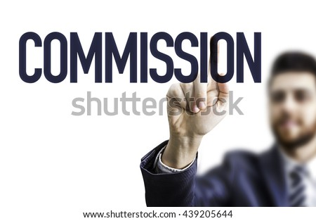 Business Man Pointing the Text: Commission - stock photo