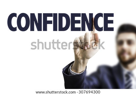 Business man pointing the text: Confidence - stock photo