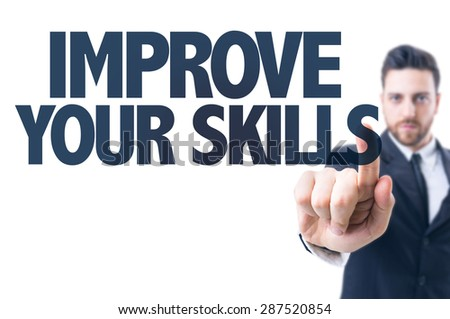 Business man pointing the text: Improve Your Skills - stock photo