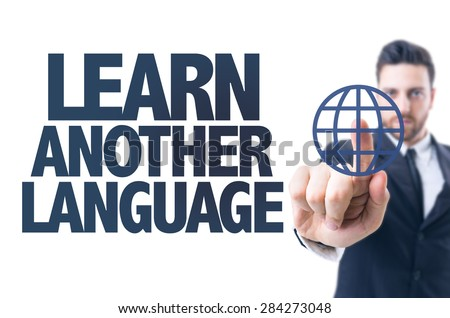 Business man pointing the text: Learn Another Language - stock photo