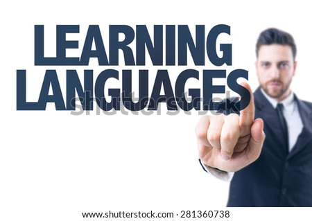 Business man pointing the text: Learning Languages - stock photo