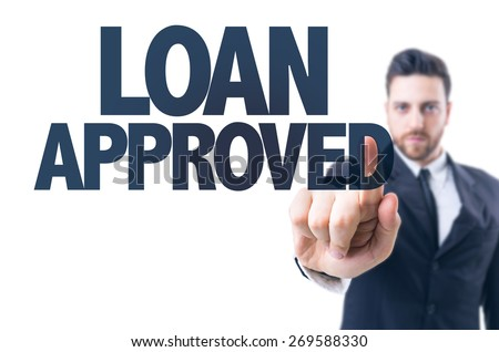 Business man pointing the text: Loan Approved - stock photo