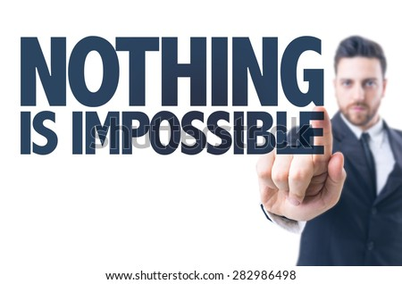 Business man pointing the text: Nothing is Impossible - stock photo