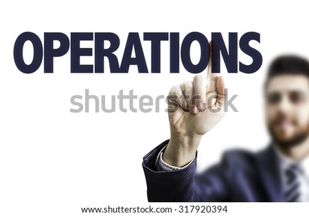 Business man pointing the text: Operations - stock photo
