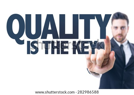 Business man pointing the text: Quality is the Key - stock photo