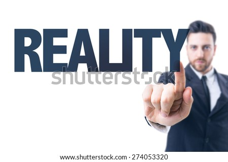 Business man pointing the text: Reality - stock photo