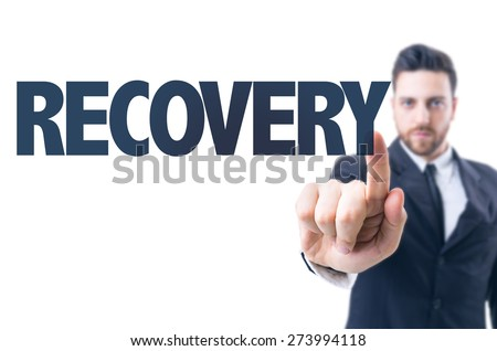 Business man pointing the text: Recovery - stock photo