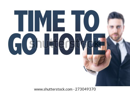 Business man pointing the text: Time to Go Home - stock photo