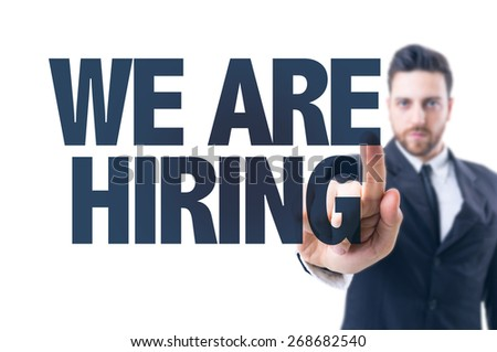 Business man pointing the text: We Are Hiring - stock photo