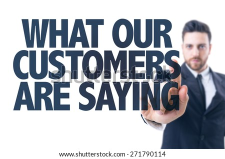 Business man pointing the text: What Our Customers Are Saying - stock photo