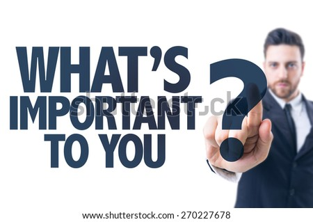 Business man pointing the text: What's Important to You? - stock photo