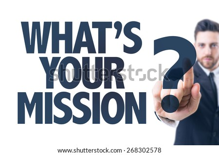 Business man pointing the text: Whats Your Mission? - stock photo