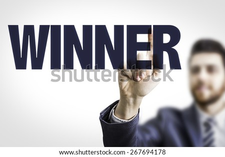 Business man pointing the text: Winner - stock photo