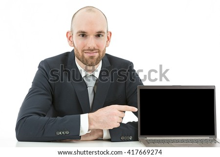 Business man pointing to copy space on his laptop