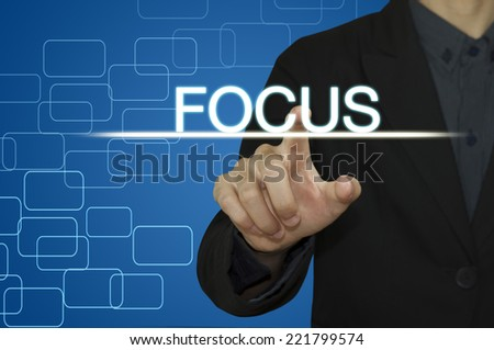 Business man pointing to FOCUS on computer screen. - stock photo