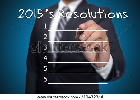 Business man pointing to 2015's resolution - stock photo