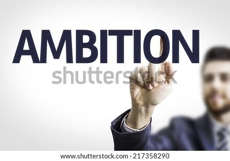 Business man pointing to transparent board with text: Ambition - stock photo