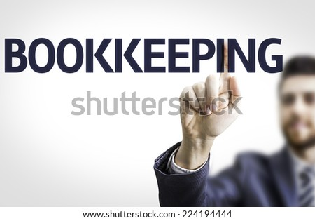 Business man pointing to transparent board with text: Bookkeeping - stock photo