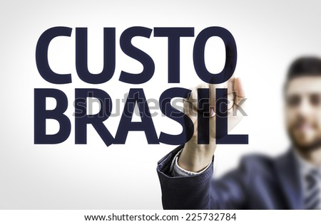 Business man pointing to transparent board with text: Brazil Cost (In Portuguese) - stock photo