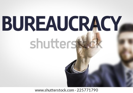 Business man pointing to transparent board with text: Bureaucracy - stock photo