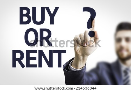 Business man pointing to transparent board with text: Buy or Rent? - stock photo