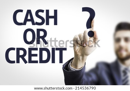 Business man pointing to transparent board with text: Cash or Credit?  - stock photo