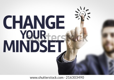 Business man pointing to transparent board with text: Change Your Mindset - stock photo