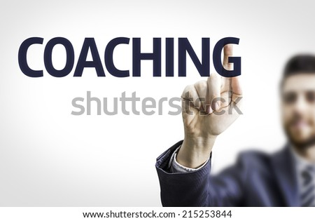 Business man pointing to transparent board with text: Coaching  - stock photo