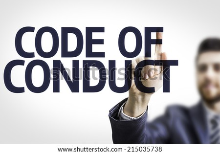 Business man pointing to transparent board with text: Code Of Conduct  - stock photo