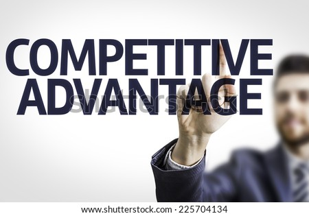 Business man pointing to transparent board with text: Competitive Advantage - stock photo