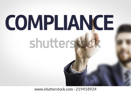 Business man pointing to transparent board with text: Compliance - stock photo