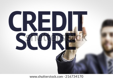 Business man pointing to transparent board with text: Credit Score - stock photo