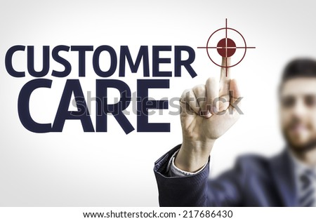 Business man pointing to transparent board with text: Customer Care - stock photo