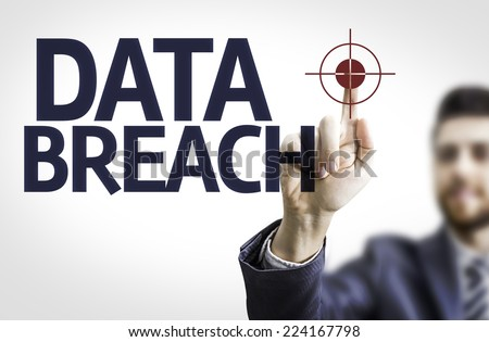 Business man pointing to transparent board with text: Data Breach - stock photo
