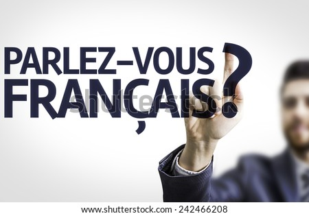 Business man pointing to transparent board with text: Do You Speak French? (In French) - stock photo