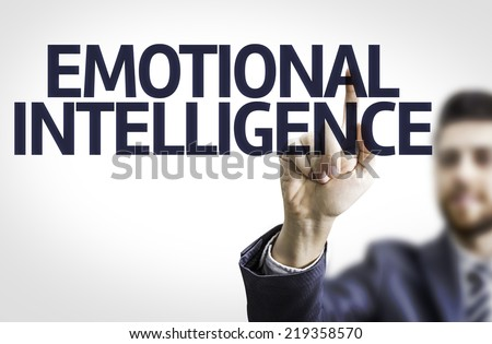 Business man pointing to transparent board with text: Emotional Intelligence - stock photo