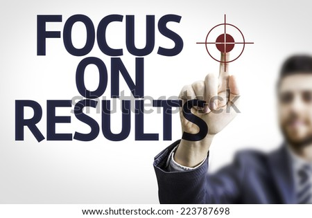 Business man pointing to transparent board with text: Focus on Results - stock photo